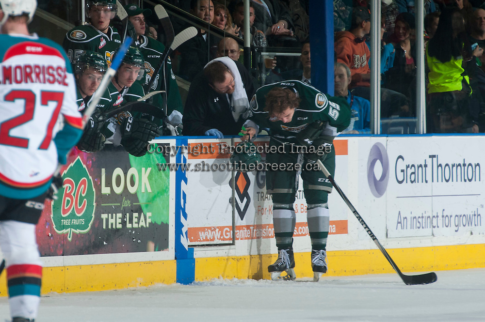 KELOWNA, CANADA - JANUARY 23: Gunnar Wegleitner #55 of Everett Silvertips stands at the boards with team athletic therapist after a check against the Kelowna Rockets on January 23, 2015 at Prospera Place in Kelowna, British Columbia, Canada.  (Photo by Marissa Baecker/Shoot the Breeze)  *** Local Caption *** Gunnar Wegleitner;