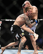 "SYDNEY, AUSTRALIA, FEBRUARY 27, 2011: Curt Warburton (left) is stopped short by an elbow stike from Maciej Jewtuszko during ""UFC 127: Penn vs. Fitch"" inside Acer Arena in Sydney, Australia on February 27, 2011."