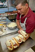 Brian Sanders of the Texas (hot weiner) Lunch handles five hot dogs.at once while serving up supper at the Carlisle St. eatery.  Texas.Lunch has been around since 1961 and was recently honored for.serving the best hot dogs in York County.