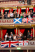 Joining hands for Auld Lang Syne. The Last Night of the BBC Proms at the Royal Albert Hall, London -  With the usual wide range of popular music including - a Mary Poppins medley, Ol Man River, the Sabre Dance, Rule Britannia, Pomp and Circumstance and Jerusalem. Performed by conductor, Sakari Oramo, the BBC Symphony Orchestra, Chorus and Singers with soloists including Ruthie Henshall. PRESS ASSOCIATION Photo. Picture date: Saturday September 13, 2014. Photo credit should read: Guy Bell/PA Wire