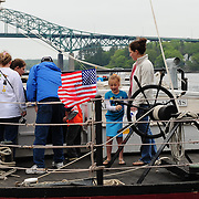 Visitors about the gundalow Captain Edward H. Adams, during the Sail Portsmouth 2011 festival in Portsmouth, NH.