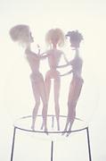 three barbie dolls together
