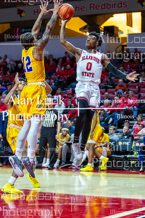 NORMAL, IL - December 07:  DJ Horne one hands the ball at the hoop with Justin Thomas approaching during a college basketball game between the ISU Redbirds and the Morehead State Eagles on December 07 2019 at Redbird Arena in Normal, IL. (Photo by Alan Look)
