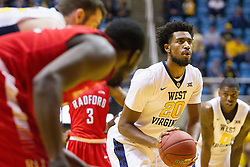 Dec 20, 2016; Morgantown, WV, USA; West Virginia Mountaineers forward Brandon Watkins (20) shoots a free throw during the second half against the Radford Highlanders at WVU Coliseum. Mandatory Credit: Ben Queen-USA TODAY Sports