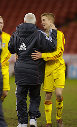 Sheffield, England - Thursday, February 15, 2007: Liverpool's Stephen Darby celebrates  his side's 3-1 victory over Sheffield United with Head of Youth Development Steve Heighway during the FA Youth Cup Quarter-Final match at Bramall Lane. (Pic by David Rawcliffe/Propaganda)