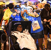 Wheelchair Half Marathon crew members, from left to right, Mary Delp, Amy Vinson and Nancy Lochman take a souvenir photo before beginning their race with Jon Crais, bottom, on Sunday, March 22, 2015, in Atlanta. Despite a steady rain, runners from 46 states and 22 countries participated in the Publix Georgia Marathon & Half Marathon, Luckie 5K and Wheelchair Half Marathon. David Tulis / AJC Special