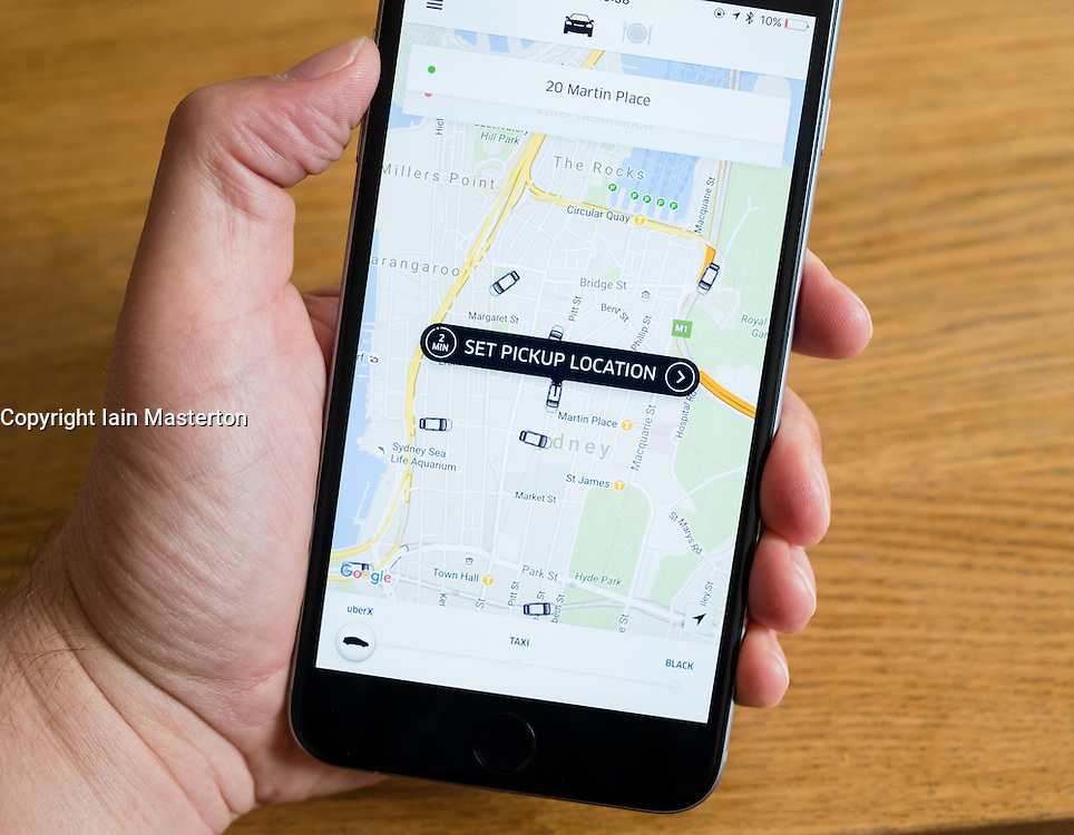 Uber taxi booking app showing Sydney, Australia on iPhone 6 smart phone