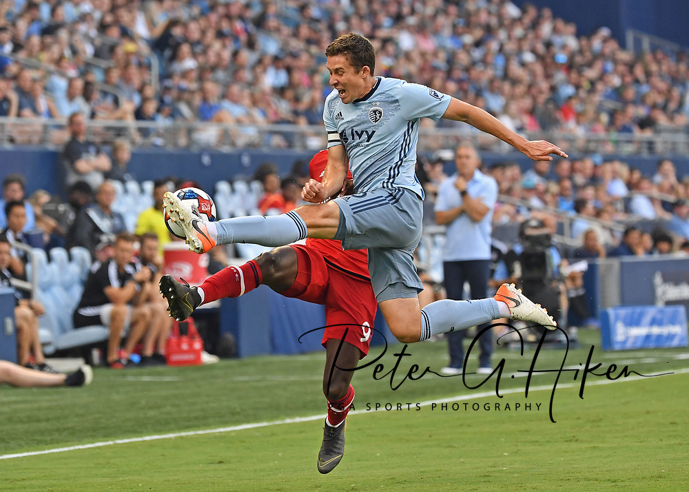 Sporting Kansas City defender Matt Besler (5) makes a play on the ball during the first half against Chicago Fire forward C.J. Sapong (9) at Children's Mercy Park.