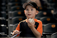 PHOENIX, AZ - APRIL 06:  A San Francisco Giants fan holds up an autographed baseball prior to the MLB game between the San Francisco Giants and Arizona Diamondbacks at Chase Field on April 6, 2017 in Phoenix, Arizona.  (Photo by Jennifer Stewart/Getty Images)