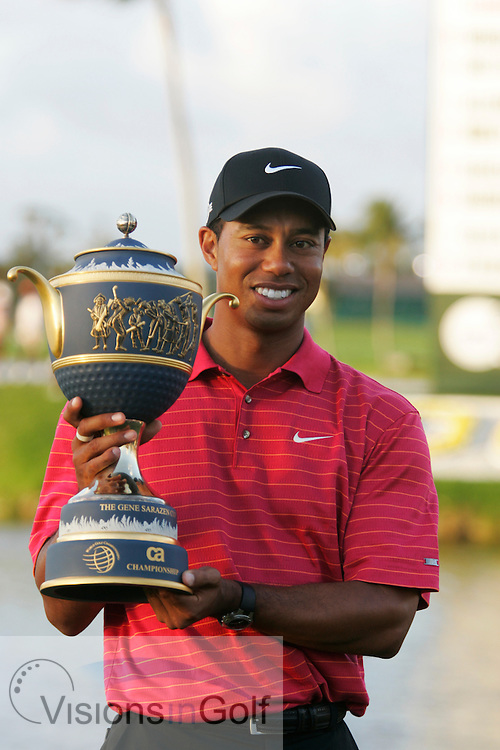 Tiger Woods on the final day after winning with the trophy<br /> WGC CA Championship, Doral, Blue monster GC, Florida USA. March 2007. <br /> Picture Credit:   Mark Newcombe / visionsingolf.com