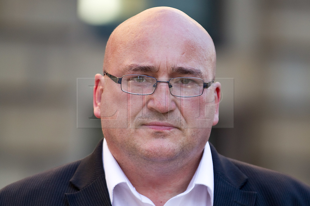 "© Licensed to London News Pictures . FILE PICTURE DATED 08/09/2012 .  Manchester , UK . DOMENYK NOONAN (pictured in Manchester City Centre) is due to appear in court today (30th January 2013) accused of raping a 15 year old boy . In total Noonan is charged with four counts of rape and false imprisonment . The organised crime boss and star of documentary "" At Home With the Noonans "" also goes under the name Lattlay-Fottfoy and is a cousin of Mark Duggan , whose shooting sparked off riots in London and across England in the summer of 2011 . Photo credit : Joel Goodman/LNP"