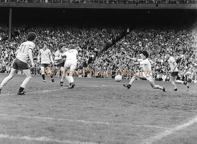 Dublin runs to kick the ball during the the Kerry v Dublin All Ireland Senior Gaelic Football Final in Croke Park on the 24th of September 1978. Kerry 5-11 Dublin 0-9.