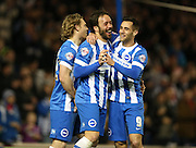 Inigo Calderon, Brighton defender celebrates scoring a goal with Craig Mackail-Smith, Brighton striker and Sam Baldock, Brighton striker during the Sky Bet Championship match between Brighton and Hove Albion and Leeds United at the American Express Community Stadium, Brighton and Hove, England on 24 February 2015.