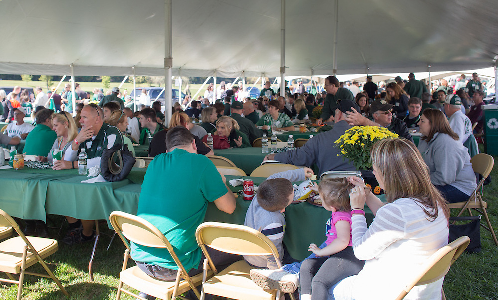 Ohio University College of Business alumni tailgate before the Homecoming football game with other alumni and their families on October 10, 2015 at Ohio University's Tailgreat Park. Photo by Emily Matthews