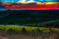 """Dramatic sunset over an ancient Tuscan farm along the Val d'Orcia""...<br />