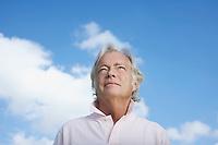 Portrait of senior man against sky