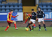 16th December 2017, Dens Park, Dundee, Scotland; Scottish Premier League football, Dundee versus Partick Thistle; Dundee's Faissal El Bakhtaoui battles for the ball with Partick Thistle's Ryan Edwards while Partick Thistle's Blair Spittal and Dundee's Jon Aurtenetxe watch