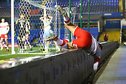 Joe Mattock of Rotherham United (3) falls over the boarding during the EFL Sky Bet League 1 match between Coventry City and Rotherham United at the Trillion Trophy Stadium, Birmingham, England on 25 February 2020.