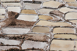 Salt Pans in Maras, Peru.  Water from an underground saltwater spring/source is diverted into hundreds of pools which then evaporate, leaving salt which is harvested and sold.