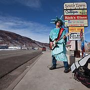 Roadside busker employed by Liberty Tax