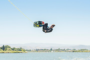 Male athlete flipping on wake board on the Snake River in Burley, Idaho.