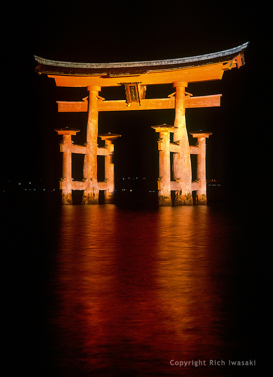 The grand torii (gateway) of Itsukushima jinja (shrine) at night, near the island of Miyajima, Hiroshima Prefecture, Japan