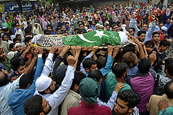 August 2, 2017 - Haal, Kashmir, India - (EDITORS NOTE: Image depicts death) Kashmiri villagers shout pro-freedom slogans as they carry body of Akeel Ahmed Bhat, a teenage boy during his funeral procession in Haal village, south of Srinagar. Akeel  sustained serious injuries when government force fired pellet and bullets on protester during clashes in Haal village. He later succumbed to  injuries at a local hospital in Indian controlled Kashmir. (Credit Image: © Umer Asif/Pacific Press via ZUMA Wire)