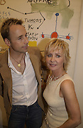 David Furnish and Lulu. Basquiat private view. Hamiltons. London. 19 June 2002. © Copyright Photograph by Dafydd Jones 66 Stockwell Park Rd. London SW9 0DA Tel 020 7733 0108 www.dafjones.com
