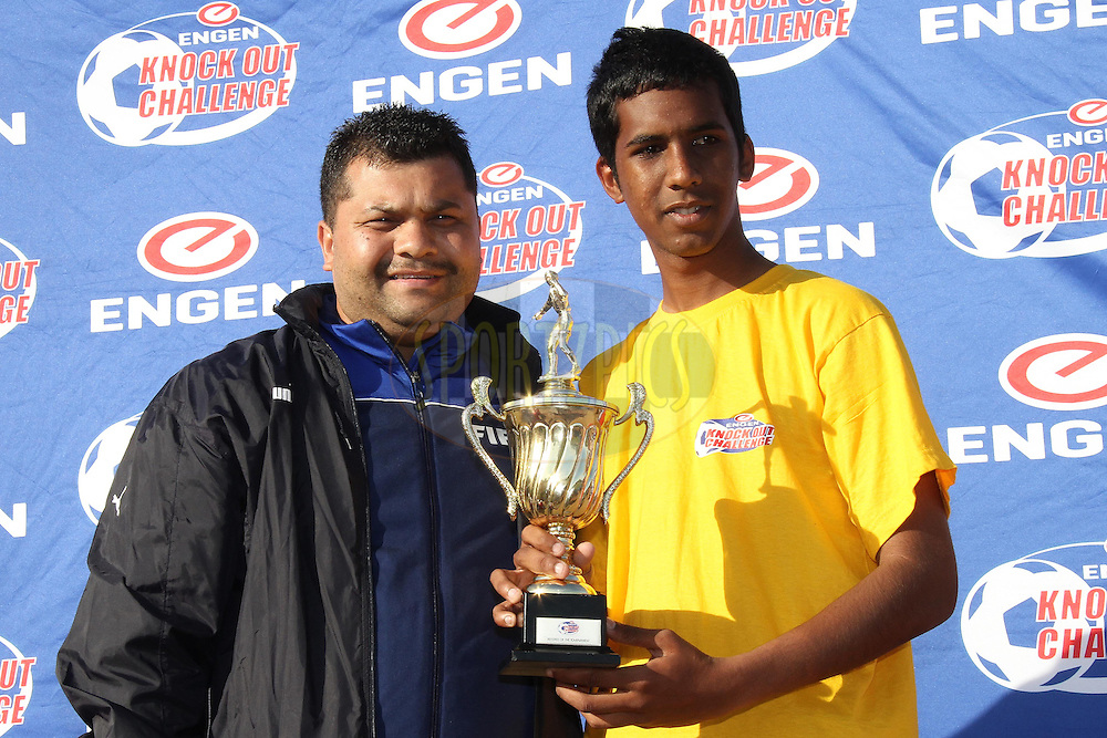 Muzzammil Walters receives the Referee of the Tournament Award from Elton Lotriet during the Final on the final day of the Engen Knock Out Challenge held at Stephen Reagan Sports Ground, Mitchells Plain in Cape Town on the 30th September 2012..Photo by Shaun Roy/ SPORTZPICS..