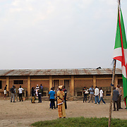 People await the opening of a polling station at Cibitoke neighbourhood in Bujumbura, to vote in the country's parliamentary elections, on June 29, 2015.