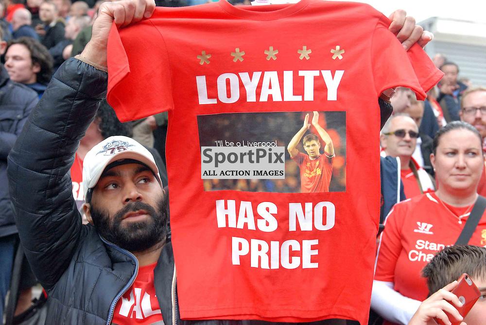 A Liverpool fan holds up a Steven Gerrard T-Shirt