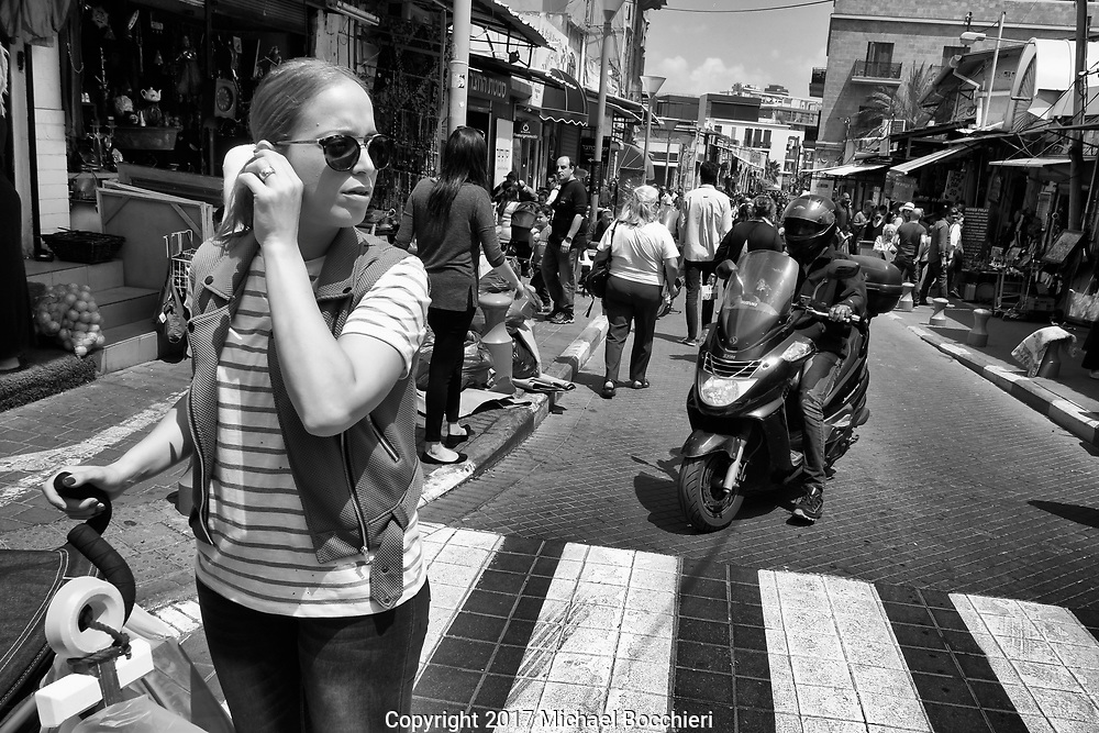TEL AVIV,  - April 14:  A woman in the street of Jaffa on April 14, 2017 in TEL AVIV, Israel.  (Photo by Michael Bocchieri/Bocchieri Archive)