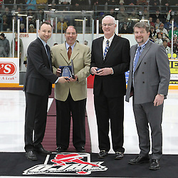 TRENTON, - Apr 15, 2016 -  Ontario Junior Hockey League game action between Trenton Golden Hawks and the Georgetown Raiders. Game 1 of the Buckland Cup Championship Series. At the Duncan Memorial Gardens, ON. 2015-2016 OJHL Awards presentation for Trainer of the Year Joe Aiello. Presented by OJHL Commissioner Marty Savoy, OHA Gary Moroney Vice Chairman of the Board Ontario Hockey Association.of the Board of Governors Scott McCrory.<br /> (Photo by Tim Bates / OJHL Images)