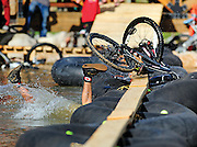 Byron Hetzler/Sky-Hi News.A competitor falls into the Winter Park Village Pond while competing in the first-ever Intergalactic Pond Crossing Championship during Crankworx Colorado on Saturday at Winter Park Resort.