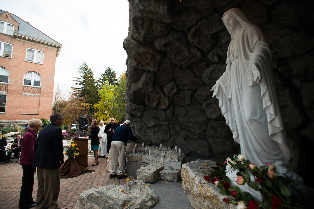 Members of the Gonzaga community attending the Dedication Mass for the new Grotto wait to light candles.<br />