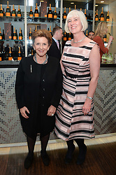 Left to right, PATSY BLOOM and MICHELLE McDOWELL at a dinner in honour of Veuve Clicquot Business Woman Award UK Previous Winners held at Moet Hennessy, 18 Grosvenor Gardens, London on 8th April 2014.