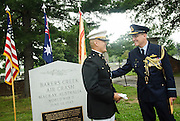 Australian Air Commodore Gary Martin speaks with Lt. Col John Orille(L), Deputy Base Command of Joint Base Myer-Henderson Hall before a ceremony marking 71th anniversary of a crash that killed 40 Army Air Corps members at Bakers Creek, Australia at Joint Base Myer-Henderson Hall in Arlington, Va. on June 13, 2014. Photo by Kris Connor
