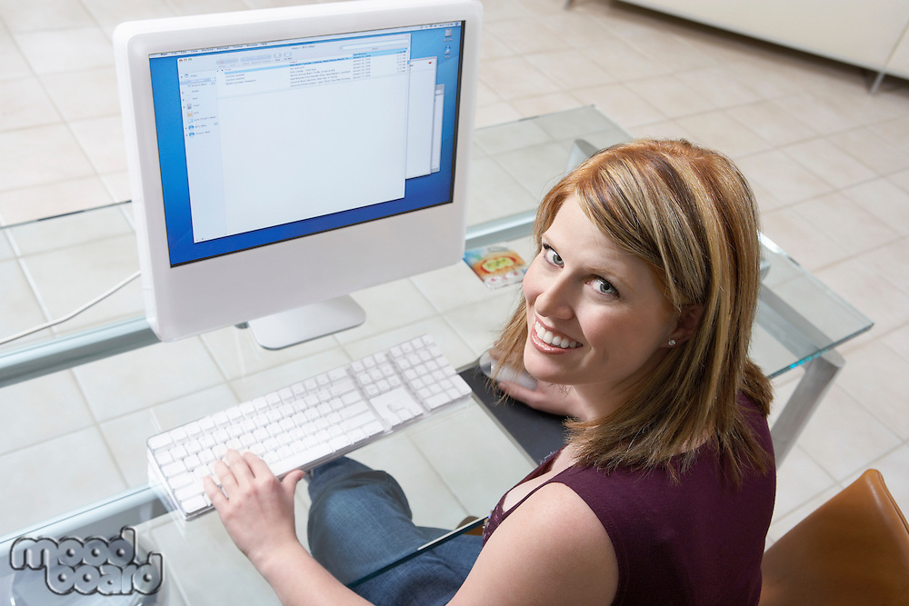 Woman sitting at computer (elevated view)