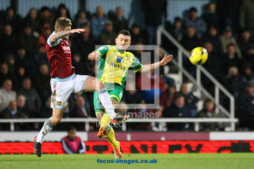 Picture by Paul Chesterton/Focus Images Ltd +44 7904 640267<br /> 11/02/2014<br /> George McCartney of West Ham and Robert Snodgrass of Norwich in action during the Barclays Premier League match at the Boleyn Ground, London
