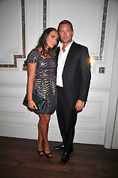 TAMARA ECCLESTONE and ROBERT MONTAGUE at a dinner hosted by designer Pauric Sweeney held in The Postilion Roon, The Langham, ondon on 23rd June 2009.