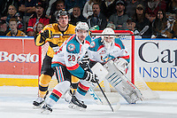KELOWNA, CANADA - MAY 13: Joe Gatenby #28 of Kelowna Rockets looks for the pass in front of Jackson Whistle #1 of Kelowna Rockets on May 13, 2015 during game 4 of the WHL final series at Prospera Place in Kelowna, British Columbia, Canada.  (Photo by Marissa Baecker/Shoot the Breeze)  *** Local Caption *** Joe Gatenby; Jackson Whistle;