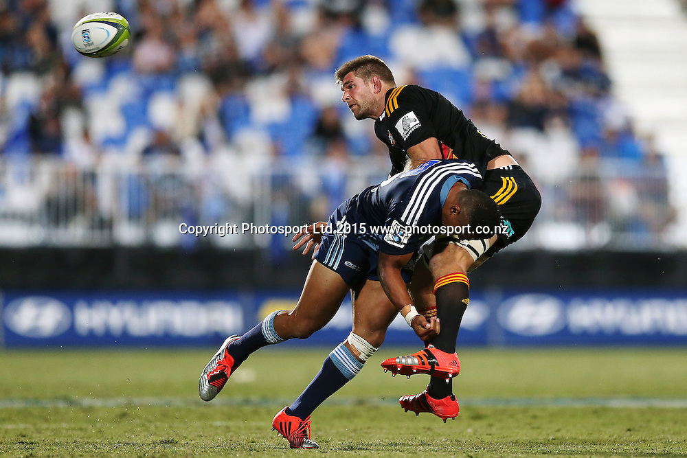 Francis Saili of the Blues tackles on Mike Fitzgerald of the Chiefs. Super Rugby match, Blues v Chiefs at QBE Stadium, Auckland, New Zealand. Saturday 14 February 2015. Photo: Anthony Au-Yeung / www.photosport.co.nz
