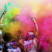 GOLD COAST, AUSTRALIA - JUNE 02:  Competitors celebrate completing the Colour Run on June 2, 2013 in Gold Coast, Australia.  (Photo by Chris Hyde/Getty Images)