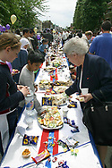 Residents enjoying a special buffet at a Golden Jubilee street party in Jubilee Street in the Stepney Green area of east London, where hundreds turned out to celebrate the 50 year reign of Queen Elizabeth II. Celebrations took place across the United Kingdom with the centrepiece a parade and fireworks at Buckingham Palace, the Queen's London residency. Queen Elizabeth ascended to the British throne in 1952 upon the death of her father, King George VI.