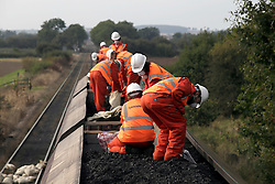 UK ENGLAND COTTAM 23SEP14 - Activists atop a coal waggon shovel coal into sacks during a protest against coal shipments to the UK.<br /> <br /> Over fifty Greenpeace UK activists stopped a freight train carrying 1,500 tonnes of coal to Cottam power station in Nottinghamshire, England.<br /> <br /> jre/Photo by Jiri Rezac / Greenpeace<br /> <br /> &copy; Jiri Rezac 2014