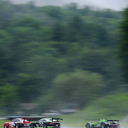 July 23, 2010; David Brabham and Simon Pagenaud's Patrón Highcroft Racing Honda Performance Development ARX-01c follows GMG Racing Bret Curtis and James Sofronas' Porsche 911 GT3 Cup and Paul Gentilozzi and Marc Goossens' Jaguar RSR Jaguar XKR during practice for The American Le Mans Series Northeast Grand Prix at Lime Rock Park in Lakeville, Conn.