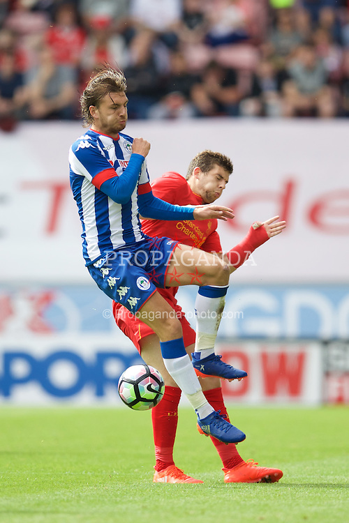 WIGAN, ENGLAND - Sunday, July 17, 2016: Liverpool's Jon Flanagan in action against Wigan Athletic's Alex Gilbey during a pre-season friendly match at the DW Stadium. (Pic by David Rawcliffe/Propaganda)