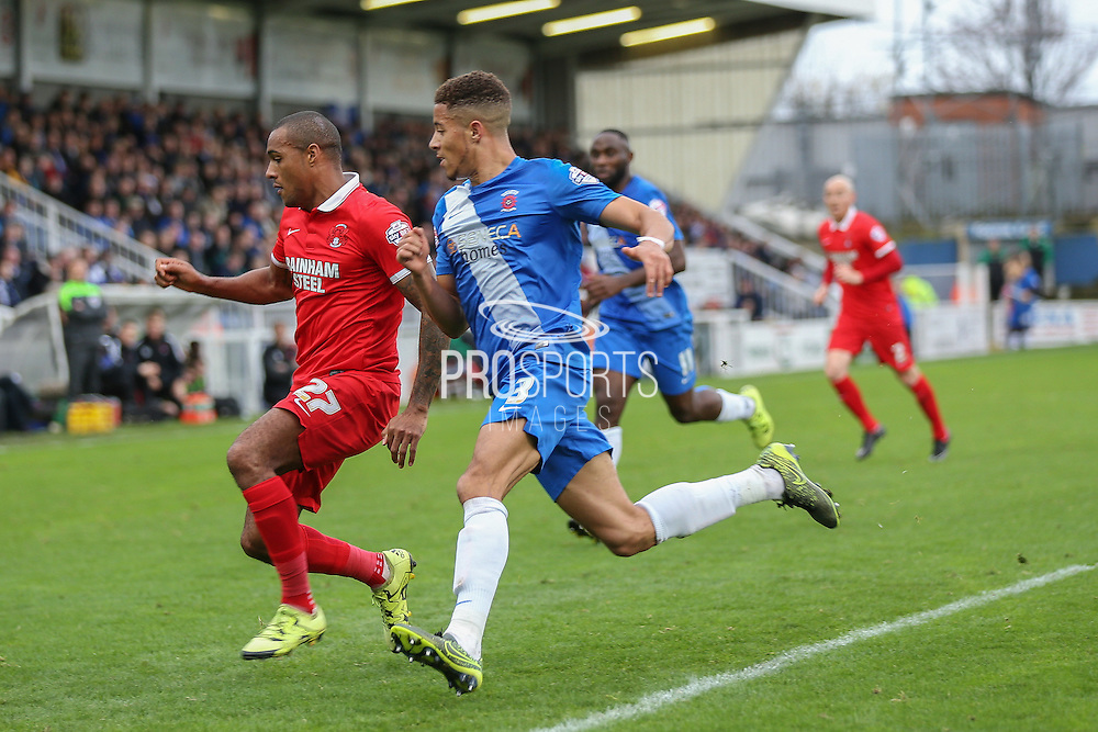 Leyton Orient forward Jay Simpson  and Hartlepool United defender Jake Carroll  during the Sky Bet League 2 match between Hartlepool United and Leyton Orient at Victoria Park, Hartlepool, England on 15 November 2015. Photo by Simon Davies.
