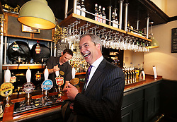 UKIP leader Nigel Farage celebrates his Local Election results with a pint of beer in the Marquis of Granby pub in Westminster, Friday, 3rd May 2013.   Photo by: Stephen Lock / i-Images