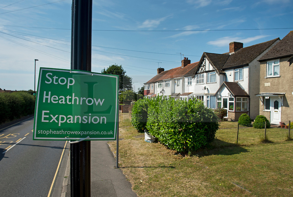 "© London News pictures...  01/07/2015. Harmondsworth, UK. A ""Stop Heathrow Expansion"" signs in the village of Harmondsworth in West London. Harmondsworth is due to be demolished to make way for a third runway at Heathrow Airport if plans go ahead. The airports commission today (Weds) gave it's backing for the £18.6bn plan for a third runway at Heathrow. Photo credit: Ben Cawthra/LNP"